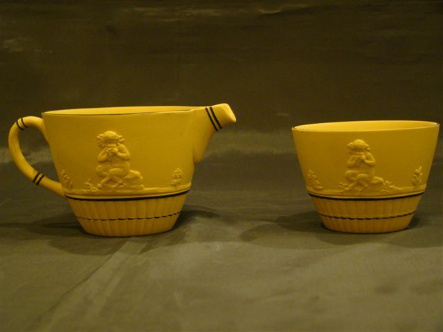 Wedgwood mustard yellow jasperware creamer and sugar centaur