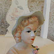 Lovely pale Lady Head Vase Green Hat and Yellow Flowers