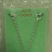 Vogue Dolls Jill Head Rhodium Plated Locket, Mint in Original Packaging, 1957.