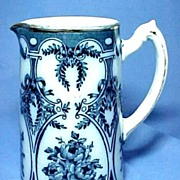 Antique Flow Blue Pitcher with Roses