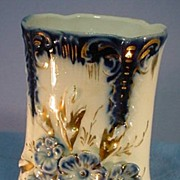 Flow Blue Toothbrush Holder Vase with Relief Molded Flowers.