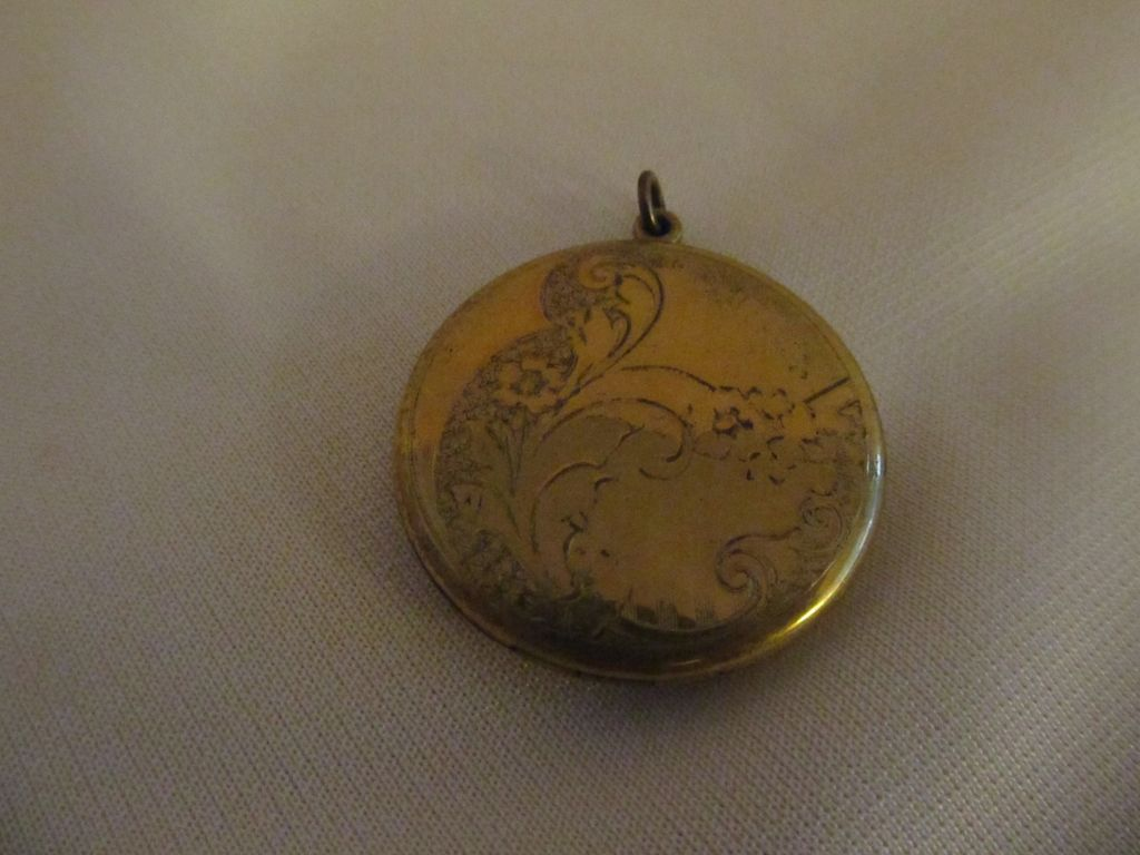 Lovely Atrice Locket with Bee Mark
