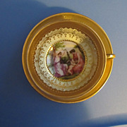Gold Encrusted German Demitasse with Romantic Putti Scene