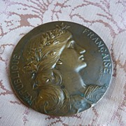 Decorative vintage French heavy weight bronze medal signed Daniel Dupuis