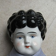Pretty China Head in Antique Coat