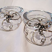 Pair largeDanish glass bowls with sterling silver tops.