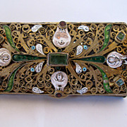 Antique silver box, decorated with real emeralds, garnets and enamel gilded.