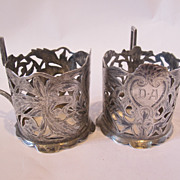 19th Century set of two hand made silver glass holders,decorated with niello, marked.