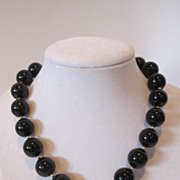 Art Deco style onyx necklace,decorated with 2ct. diamonds and 14k gold