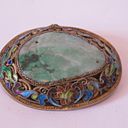 Chinese export silver brooch pin decorated with large carved green jade.