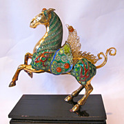 Chinese export gilded silver horse, decorated with enamel and carnelian.
