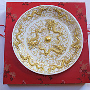 Chinese export large porcelain charger. Decorated with Gold applied dragons.