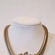 Coro sterling silver gilded necklace decorated with rhinestones.