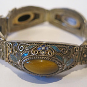 Chinese export silver and enamel bracelet. Decorated with Tiger eye, marked.