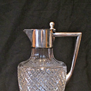 Antique cut glass jug with 800 silver top and handle. Beautiful.