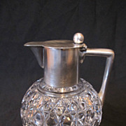 Antique Art Deco style cut glass jug with 800 silver top and handle