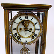 Ansonia Antique clock made from bronze and crystal. Decorated with rhinestones.
