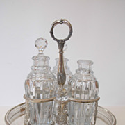 Antique French sterling silver cruet set with original baccarat bottles.