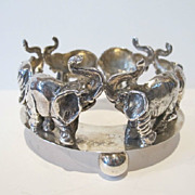 Vintage sterling silver wine coaster. Hand made decorated with elephants.
