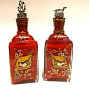 19 century pair of red color decanters. Decorated with enamel, silver dog & sail boat stoppers