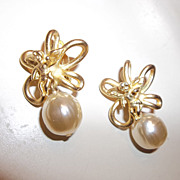 Large faux pearl and cherub earrings, marked