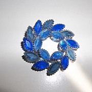 Pretty blue glass rhinestone wreath brooch