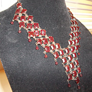 Gorgeous over the top, BIB, drippy ox blood colored rhinestone necklace