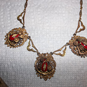 Art Deco Brass necklace with Red enamel painted tear drop shape beads