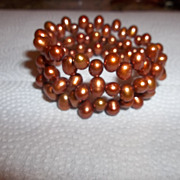 Gorgeous copper colored cultured pearls.  wraps three times