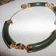 Bracelet with possible faux jade and chinese writing links