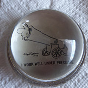 Herb Gardner 1959 Glass paper weight,  I work well under pressure cannon