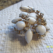 Vintage Milk glass brooch with over lapping rhinestones