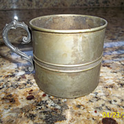Childs tin cup marked Empire Silver plate with an A in the center