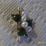 The pendant is fresh water pearls and jade.
