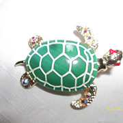 Large enamel plastic back with AB rhinestone feet,