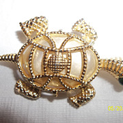 Fancy turtle brooch with large encased faux pearl