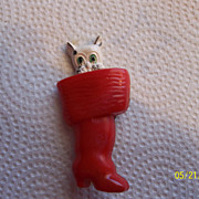 Celluloid white puppy in a red stocking brooch