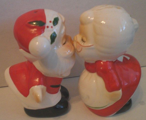 Mr. and Mrs. Kissing Santa Claus