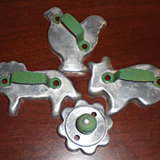 Four Vintage Animal and Flower Cookie Cutters with Green Handles