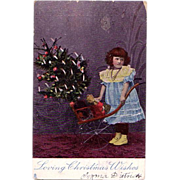 Christmas Postcard of a Little Girl with a Christmas Tree