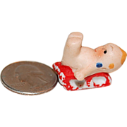 Little Itty Bitty Teeny Bisque Kewpie w/ Blue Wings on Red Sled