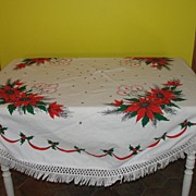 Poinsettia and Candle Oval Fringed Tablecloth