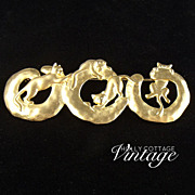 Vintage matte goldtone kitty brooch