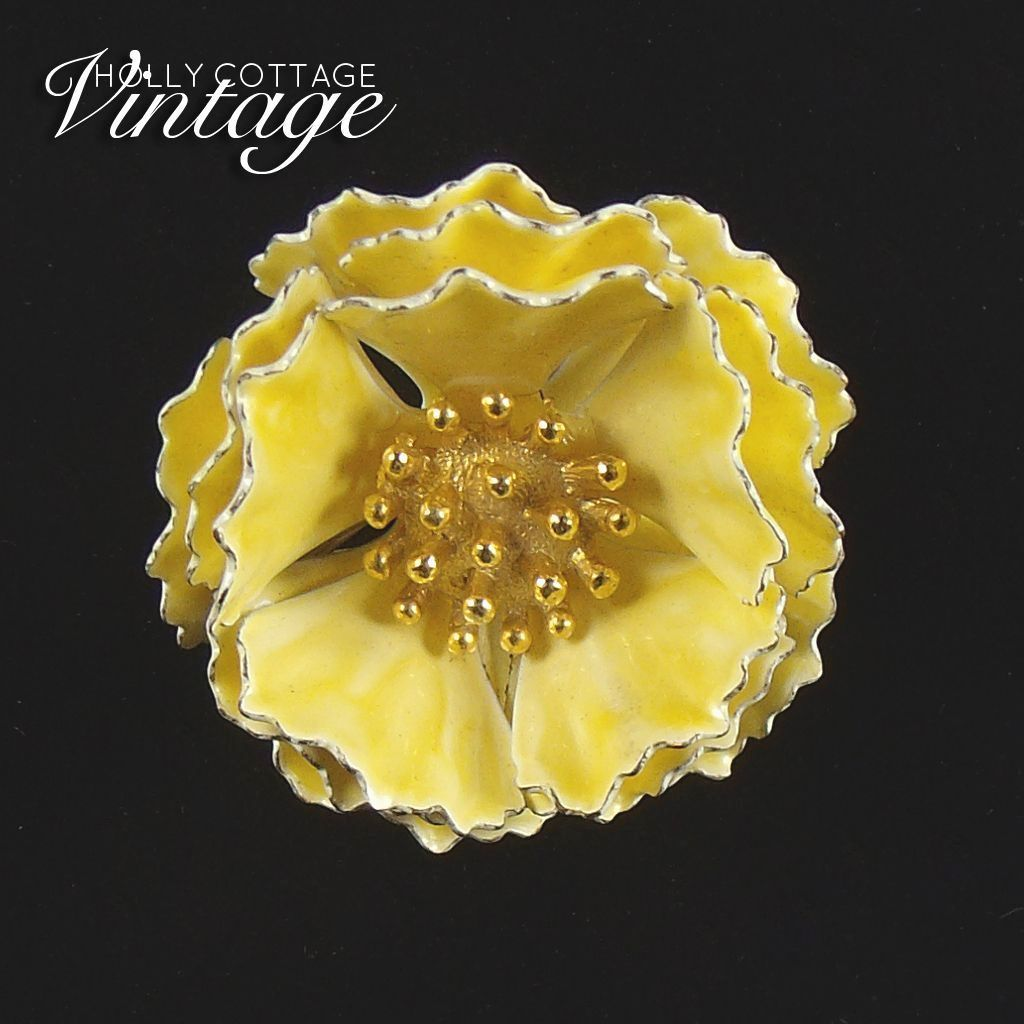 Vintage yellow enameled flower brooch