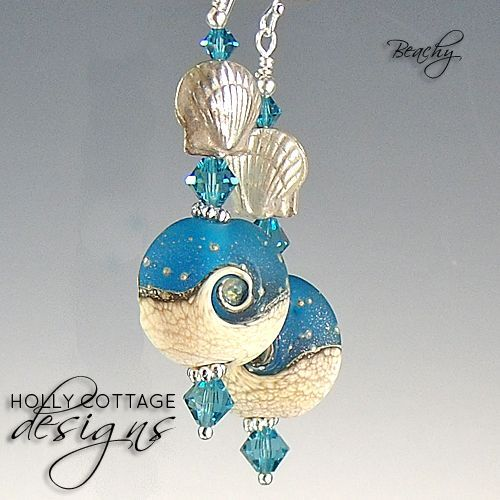 Artisan crafted lampwork and crystal earrings with silver seashells
