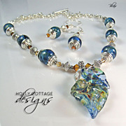 SOLD Artisan crafted necklace and earring set