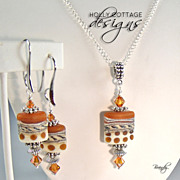 Artisan crafted lampwork pendant on chain with matching earrings
