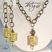 Artisan crafted lampwork pendant and earrings on bronze chain