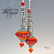SOLD Artisan crafted fiesta earrings