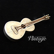 Vintage sterling silver guitar pin